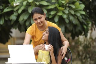 Mother Over Daughter's Shoulder on Laptop