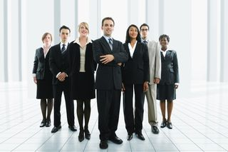 Business-team-standing-posed copy