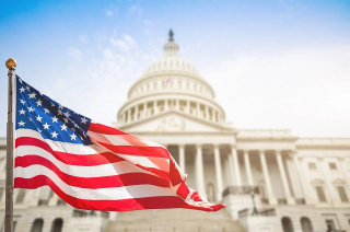 U.S. Capitol, United States of America Flag waving
